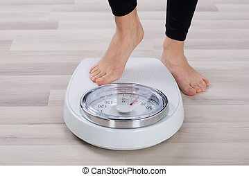 Person Standing On Weighing Scale - Low Section Of Person...