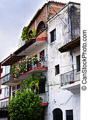 Old building in Puerto Vallarta, Mexico - Balconies with...