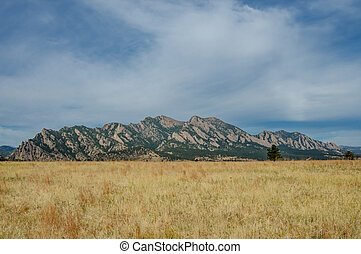 Flatiron Mountains with Dry Grassy Field near Boulder,...