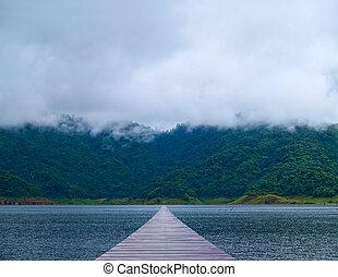 Misty mountain - Boardwalk over lake lead to misty mountain...
