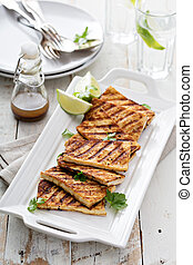 Grilled fried tofu on a plate - Grilled fried tofu on a...