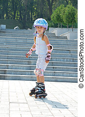 rollerblading - Four year old child rollerblading outdoor....
