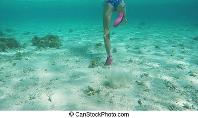 Young girl scuba diver - Children's legs running on the...
