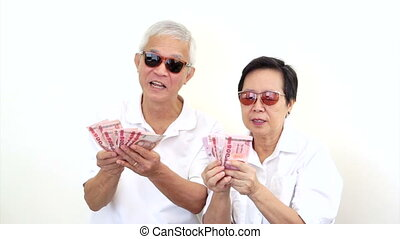 rich Asian seniors won cash - Video of happy rich Asian...