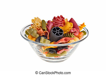 Italian colourful pasta isolated over white background in transparent bowl.