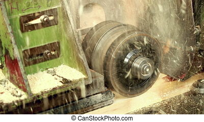 View of sawing wood at sawmill, close-up - Woodworking. View...