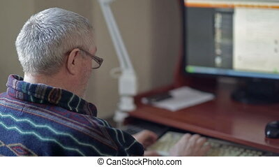 Eldery man working on a computer