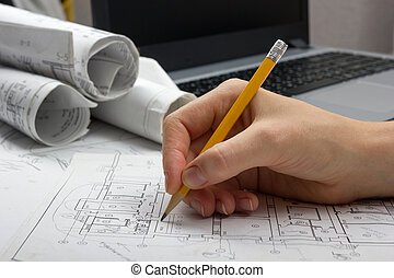 Architect working on blueprint. Architects workplace -...