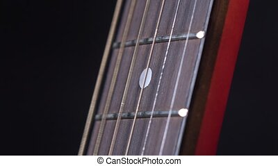 Strings of acoustic guitar, on black, close up - Strings of...