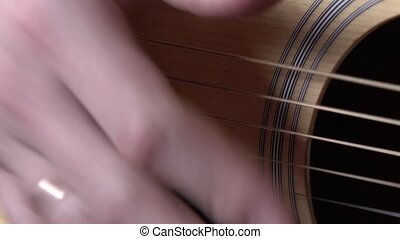 Man playing guitar, close up - Man playing guitar,...