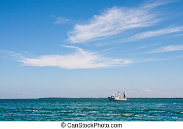 Shrimp Boat Under High Clouds - A shrimp boat under high...