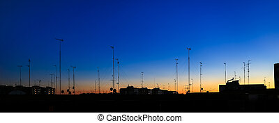 Many home TV antennas and satellite dishes mounted on the...