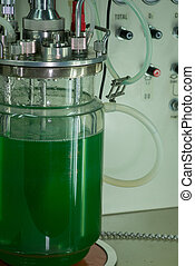 Glass beaker device with tubing - Close up of large glass...
