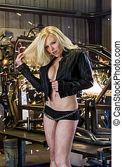 Blonde Model At Work - A blonde model poses in a garage...