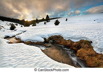 gold sunset over mountain river in winter, Todtnauberg,...