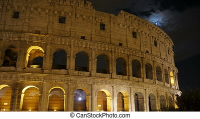 Colosseum at night, Rome, Italy, timelapse, zoom in, 4k -...