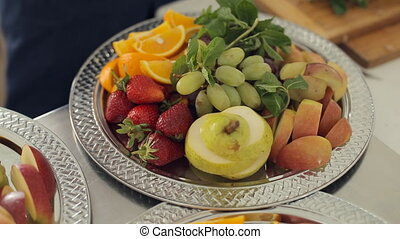 Fresh delicious pear, orange, apple, strawberries and grapes...