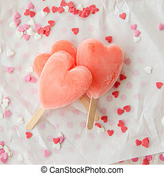 Ice cream pops in heart shape - Pink ice cream pops with...