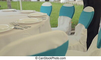 Table setting with eating utensils on a gorgeous banquet -...