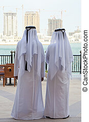 Two Anonymous Arab Men Looking At Construction of New...