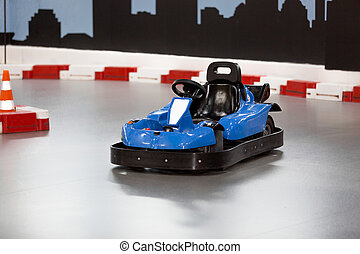 karting area with barriers and small blue kart