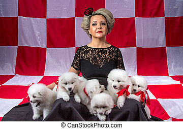 Blond woman with white puppies on plaid background