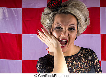 Woman with crown in hysterics on plaid background