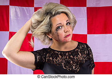 Woman with smudged make up on plaid background