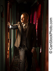 Toned portrait of man in suit at steam train - Toned...