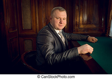 man in vintage suit posing in banker office - Portrait of...