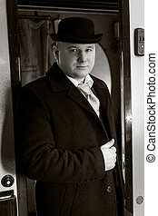 black and white portrait of confident man in bowler hat...
