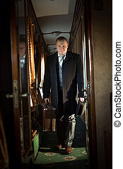 Retro photo of handsome businessman walking in the train -...