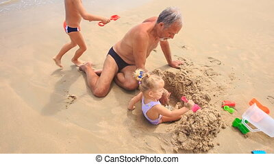 Grandpa Kids Play with Toys Sand on Beach - grandpa little...