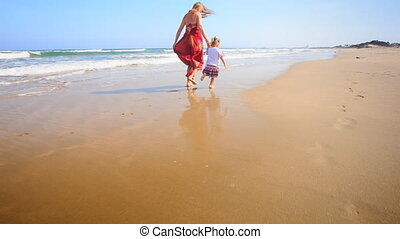 Mother in Red Little Girl Join Hands Run by Foamy Surf -...