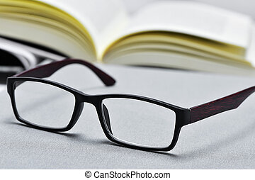 eyeglasses and open book - closeup of a pair of eyeglasses...