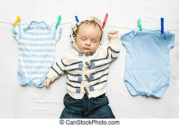 baby boy drying on clothesline after laundry - Portrait of...