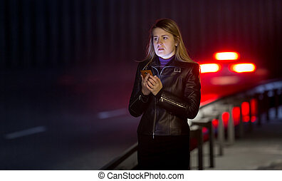 lonely woman posing at dark highway - Portrait of lonely...
