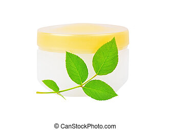 Cream can and green leaf, isolated on white background