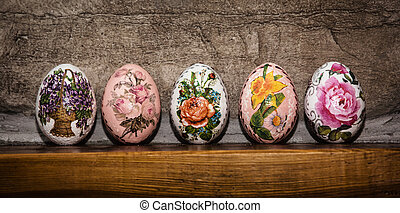 Colorful Easter eggs stacked on the wooden base, Easter...