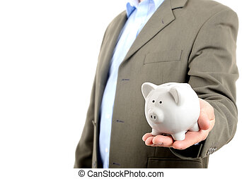 man in suit holding piggy bank