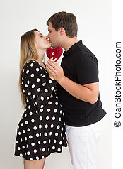 happy kissing pregnant couple in stylish clothes - Portrait...