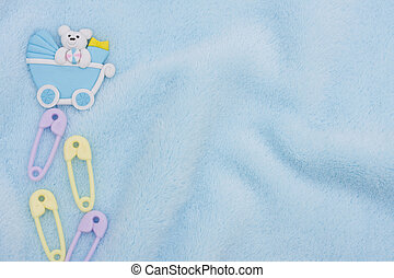 Baby Border - Diaper pins and a baby carriage on a blue...