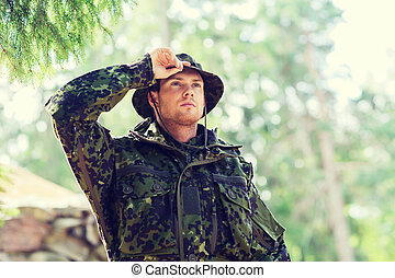 young soldier or ranger in forest - war, army and people...