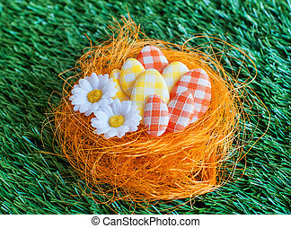 Easter eggs in a nest on artificial turf