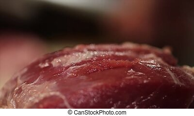 Fresh raw meat on table focus in, shef beat off meat focus...