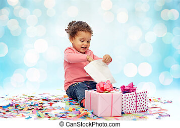 happy little baby girl with birthday presents