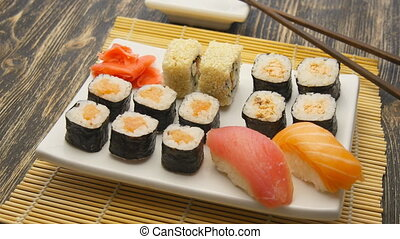 Sushi rotate on a plate - Sushi rotate on a white plate