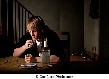 Depressed young man with alcohol - Depressed young man with...