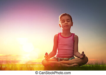 Girl is practicing yoga - Child girl in the Park. Yoga at...