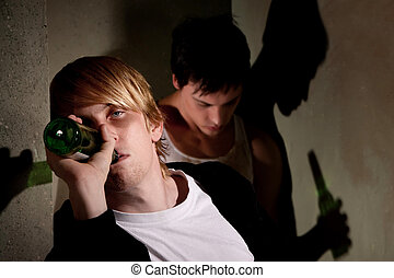 Drunk young men in hallway with bottles